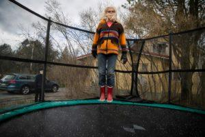 City of Tampere is set to open outdoor sports facilities for individuals and teams. Meanwhile Riitta Kurkijärvi, 70 plus, has been keeping in shape in her own backyard, bouncing on a trampoline. Kuva: Jukka Ritola